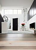 Elegant, minimalist entrance hall with gallery