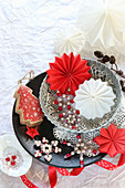 Stars and snowflakes made from beads and folded paper in stacked bowls