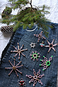 Bead stars on denim embroidered with lines