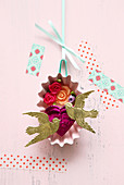 Romantic 3D diorama of fabric flowers and golden doves