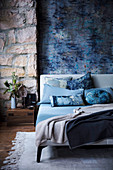Mottled blue wall and natural stone wall in the bedroom