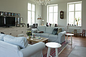 Pale loose-covered sofas in living room
