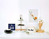 A cake stand as a shelf and various decorative items