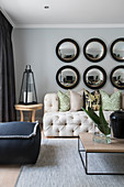 Round convex mirrors on wall of elegant living room
