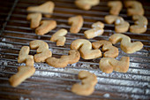 Christmas biscuits shaped like numbers 1-4 on cooling rack
