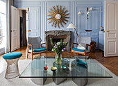 Vintage designer furniture in living room of Parisian period building