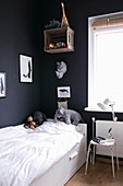 Child's bedroom with black walls
