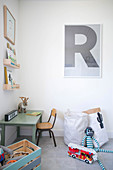 Letter R above desk and chair in child's bedroom