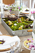 Set table with Easter arrangement in vintage baking tray