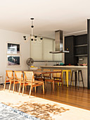 Dining table in open-plan kitchen opening straight on to terrace