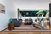 Various designer furnishings in earthy colours in living room