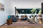 Various designer furnishings in earthy colours in living room