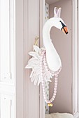 Faux swan head on door frame