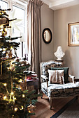 Christmas tree and Baroque armchair in living room