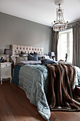 Classic bedroom in blue-grey and brown shades