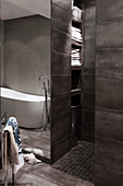 Grey modern bathroom with open-plan shower area and built-in shelves