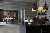 Modern log cabin with open doorway between kitchen and dining room