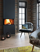 Roaring fire in modern fireplace in log cabin