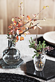 Autumnal arrangements in glass vases