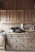 Vintage chest of drawers in open kitchen of chalet