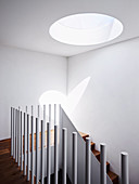 White stairwell with skylight