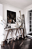 Rustic console with branches and finds from nature