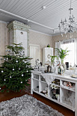 Christmas tree and white shelves in living room