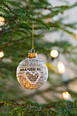 Christmas-tree bauble decorated with newspaper and bead heart