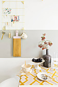 Wall-mounted table with retro tablecloth in kitchen