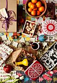 Plätzchenausstecher, Geschenk, Stempel, Mandarinen, Plätzchendosen und Glühwein auf Tisch