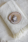 Wooden Christmas trees and slice of tree trunk on wooden blanket