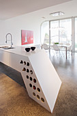 Futurist island counter with integrated wine rack in architect-designed house