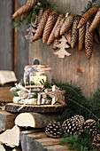 Garland of fir cones above candle lantern in wreath of birch branches