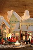 Illuminated Christmas village of pastel cardboard houses