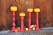 Small pumpkins on candlesticks