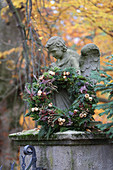 Wreath of heather and conifer twigs decorating grave