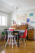 Various children's chair around table in front of piano
