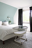 Rattan bassinet in bedroom