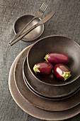 Miniature aubergines in bowl
