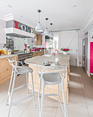 Modern bar stools at kitchen island counter
