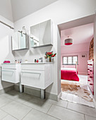 View from bathroom with twin washstands into bedroom