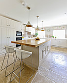 Large, bright country-house kitchen with stone-flagged floor