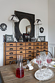 Rustic dining table and chest of drawers in dining area
