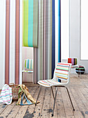 White chairs with striped upholstery and lengths of striped wallpaper