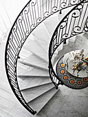 Elegant spiral marble staircase, view of marble table