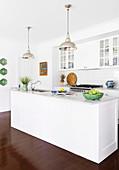 White kitchen island in open kitchen