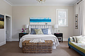 Wicker chest on the double bed and day bed in the bedroom