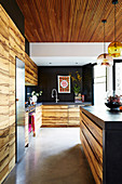Open kitchen with wooden fronts and concrete floors