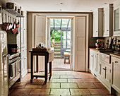 Terracotta floor tiles in country-house kitchen