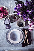 Laid table in purple and violet